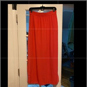 Coral skirt with adorable side skits and pockets!